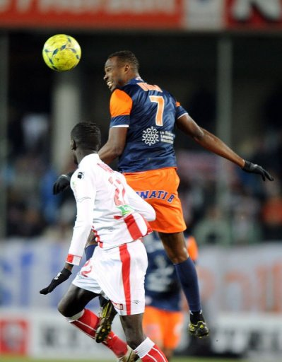 Montpellier's forward John Utaka (R) jumps for the ball over with Ajaccio's defender Fousseni Diawara