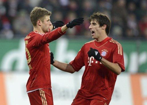 L-R: Bayern Munich's midfielder Javi Martinez and striker Thomas Mueller celebrate