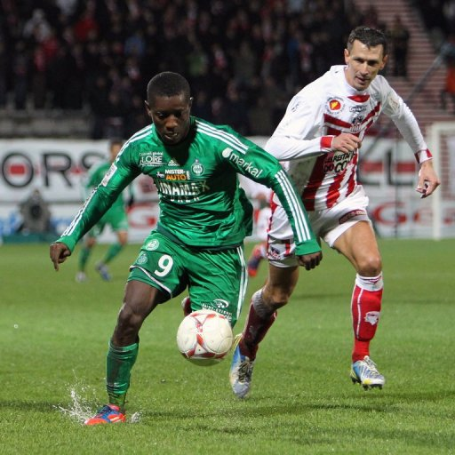 Saint-Etienne's Max Alain Gradel (L) fights for the ball with Ajaccio's Yohan Poulard
