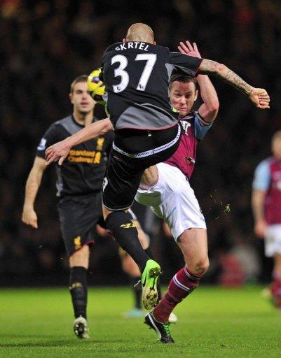 West Ham's Kevin Nolan (R) vies with Liverpool's Martin Skrtel