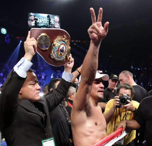 Juan Manuel Marquez waves to the crowd after knocking out Manny Pacquiao