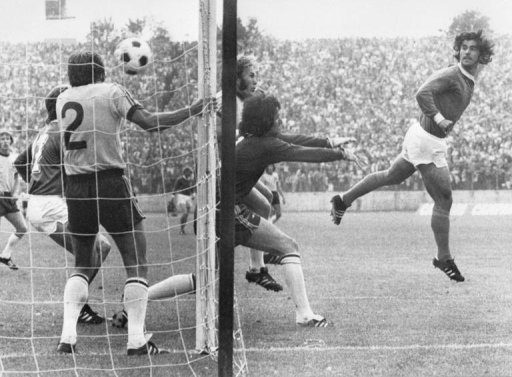 West German forward Gerd Mueller (R) scores against Australia in 1974 in Hamburg