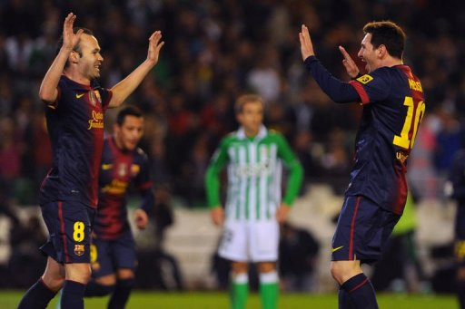 Barcelona's Lionel Messi (R) celebretes with Andres Iniesta