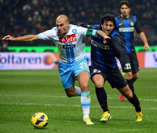 Inter Milan's Diego Milito (R) fights for the ball with Napoli's Paolo Cannavaro