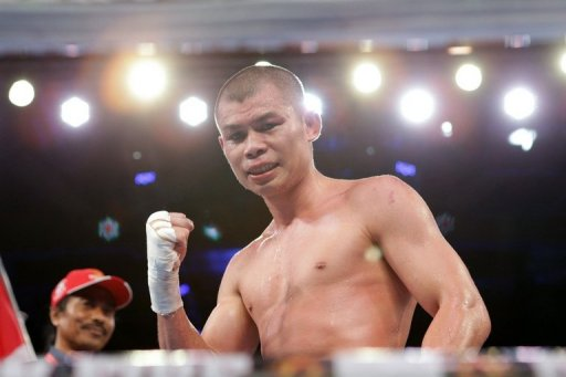 Indonesian boxer Chris John, pictured, hopes Juan Manuel Marquez will be tempted to settle another Asian score