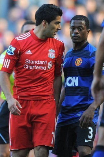 Luis Suarez (L) was hit with an eight-match suspension last year for racially abusing Patrice Evra (R)