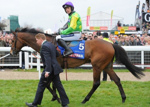 'Kauto Star' ridden by Ruby Walsh pulls up during the Cheltenham Gold Cup Chase on 16 March 2012