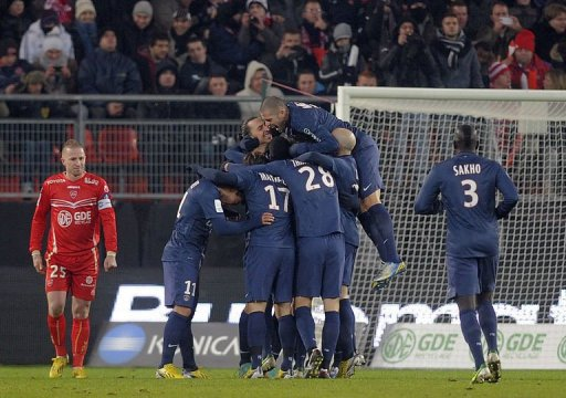 Paris Saint-Germain's Swedish forward Zlatan Ibrahimovic celebrates with teammates after scoring a goal