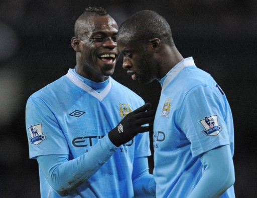 Mario Balotelli (left) speaks to Yaya Toure at the Etihad Stadium on February 25, 2012.