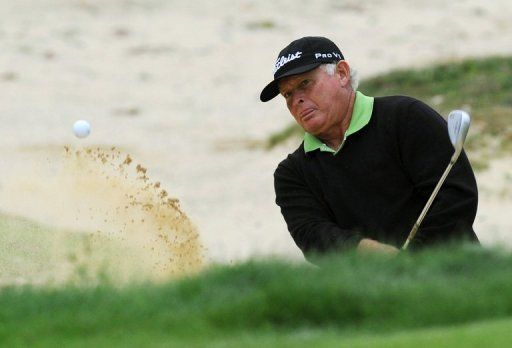 Peter Senior hits out of a bunker during the final round of the Australian Open at The Lakes course on December 9