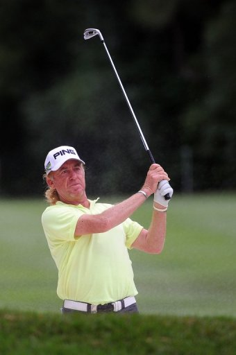 Miguel Angel Jimenez of Spain plays a shot out of a bunker at the UBS Hong Kong Open on November 17, 2012