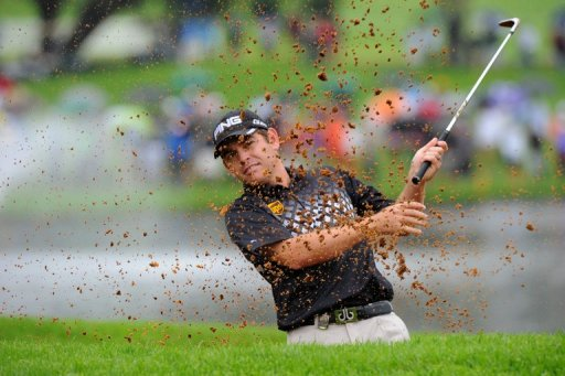 Louis Oosthuizen plays a shot out of a bunker on the 18th during the Nedbank Golf Challenge in Sun City on December 2