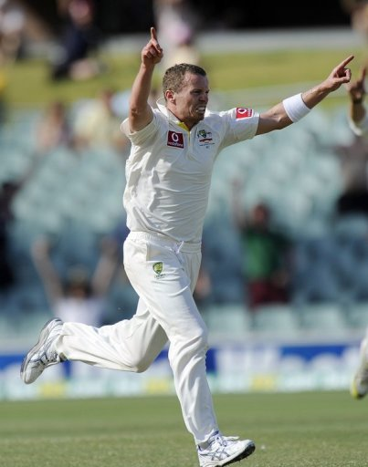 Peter Siddle celebrates the dismissal of South Africa's Dale Steyn in the second Test in Adelaide on November 26, 2012
