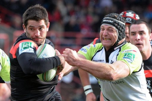 Toulouse's Florian Fritz (L) breaks away from Ospreys' Ian Gouch during their match on December 8, 2012