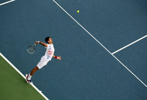 World number one Novak Djokovic serves the ball to Andy Murray during their ATP Dubai Open semi-final on March 2, 2012