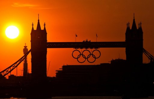 The sun sets behind the London Olympic Rings on Tower Bridge on August 10, 2012