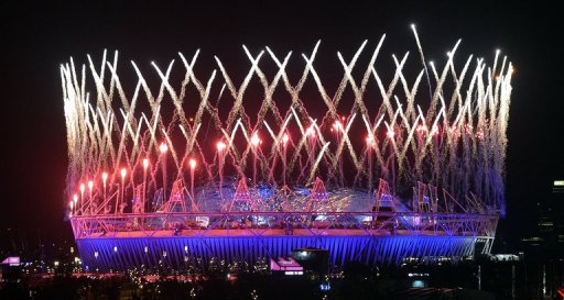 Fireworks light up the Olympic Stadium during the opening ceremony of the London Olympic Games on July 28, 2012.