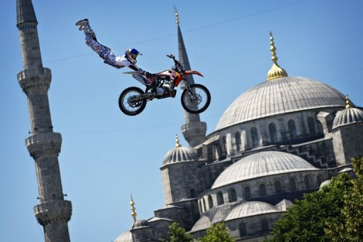 A biker performs a demo jump in front of the Blue Mosque in Istanbul on June 13, 2012