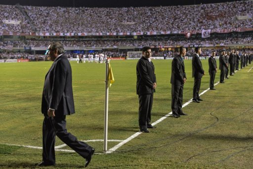 Security guards on duty ahead of the Copa Sudamericana final at Morumbi stadium, Sao Paulo, Brazil, on December 12, 2012