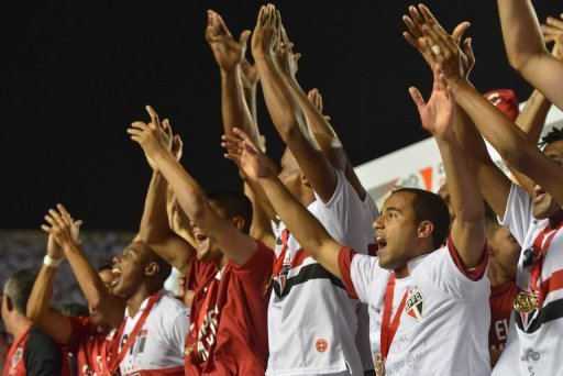 Sao Paulo players cheer as they are awarded victory in the Copa Sudamericana final in Sao Paulo on December 12, 2012