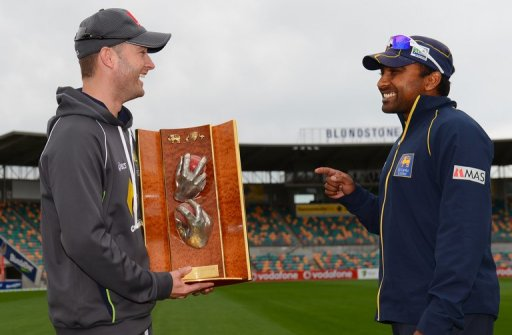 Michael Clarke (left) and Mahela Jaywardena with the Warne/Murali Trophy in Hobart on December 13, 2012.