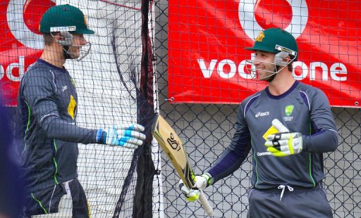 Michael Clarke (left) and team-mate Phil Hughes at a training session  in Hobart on December 13, 2012.