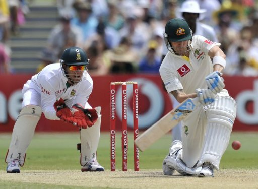 Michael Clarke (right) plays a shot against South Africa at the Adelaide Oval on November 25, 2012