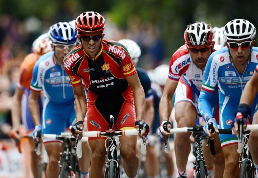 Alberto Contador (in red) rides in the Road Race World Championships on September 23, 2012 in Valkenburg, Netherlands