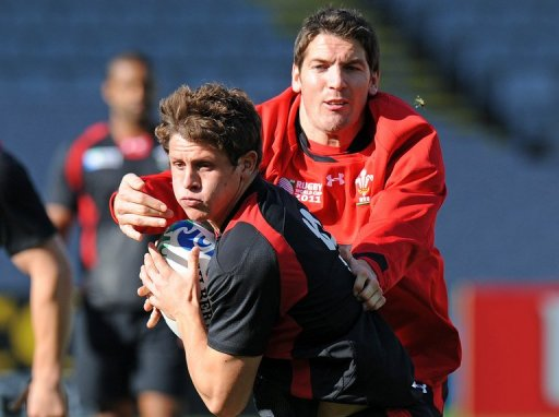 Wales' Lloyd Williams (L) and James Hook take part in the Captain's Run in Auckland on October 20, 2011