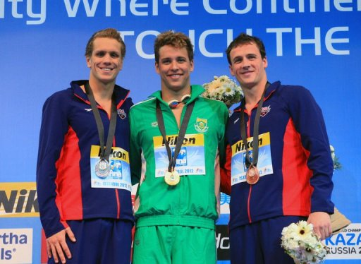 Thomas Shield (L) of USA, Chad Le Clos (C) of South Africa and Ryan Lochte of USA pose on December 13, 2012