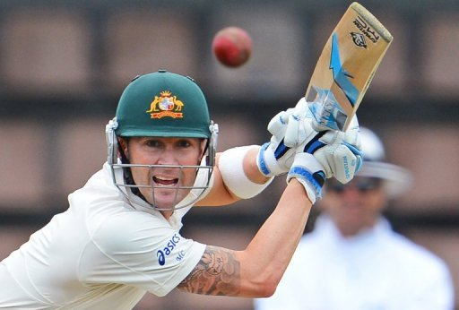 Michael Clarke drives a ball from the Sri Lankan bowling in the first Test in Hobart on December 14, 2012