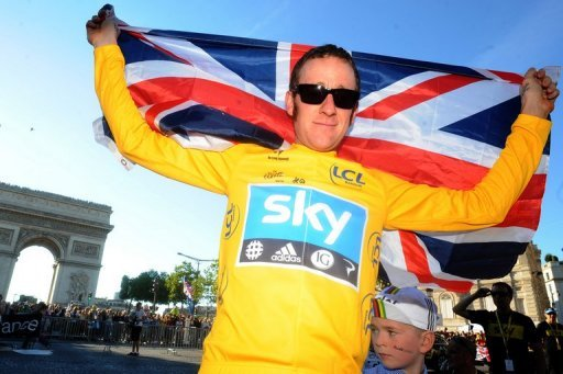 Bradley Wiggins and his son at the Arc de Triomphe on July 22, 2012 after Wiggins won the Tour de France