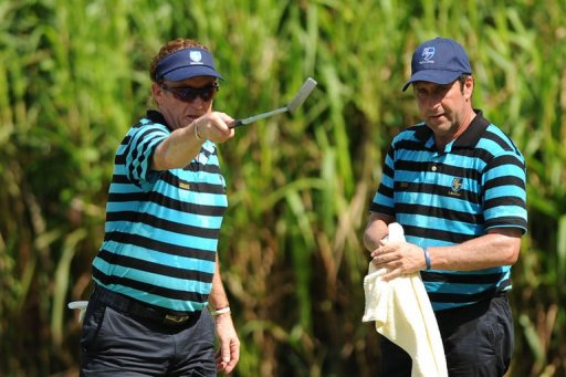 Miguel Angel Jimenez (left) and Jose Maria Olazabal play in the Royal Trophy in Brunei on December 14, 2012