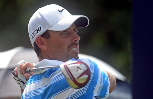 Charl Schwartzel of South Africa hits a shot on December 8, 2012