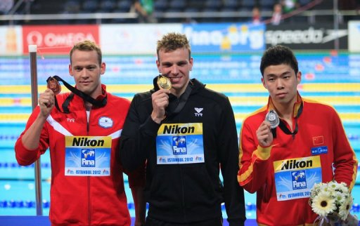 Paul Biedermann of Germany, Yun Hao of China (R) and Mads Glaesner (L) on December 14, 2012