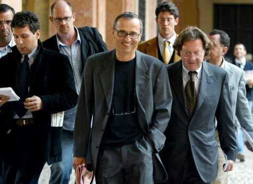 Italian doctor Michele Ferrari (C) leaves the Bologna's tribunal followed by journalists and his lawyer October 1, 2004