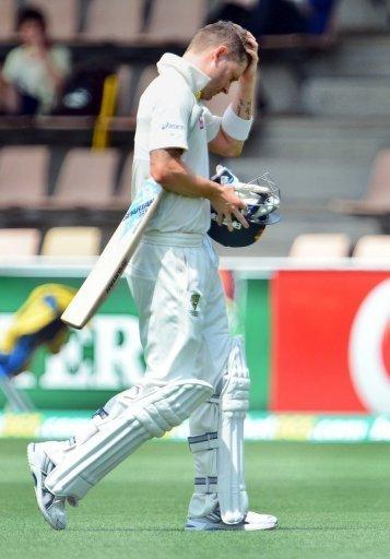 Australia's batsman Michael Clarke reacts after been dismissed by Sri Lanka, in Hobart, on December 15