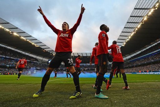Man United's players celebrate Robin Van Persie's (L) goal against Man City, at the Etihad stadium, on December 9, 2012