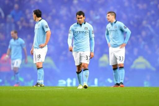 Man City's players, seen here after their loss to Man United at the Etihad stadium in Manchester, on December 9, 2012