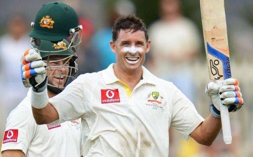 Australia's batsman Mike Hussey (right) celebrates his century against Sri Lanka, in Hobart, on December 15