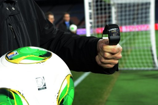 A FIFA official displays new goal-line technology for the press in Yokohama on December 5, 2012