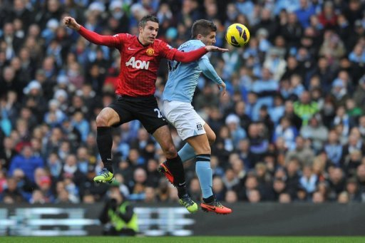 City's defender Matija Nastasic (right) vies with United's striker Robin Van Persie in Manchester, December 9, 2012