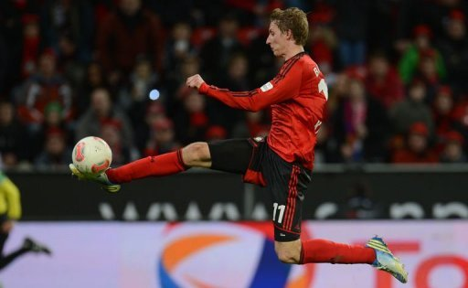 Leverkusen's striker Stefan Kiessling scores on December 15, 2012