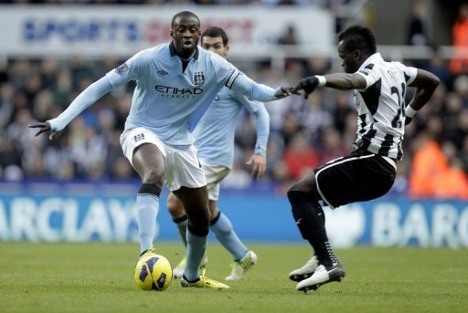 Newcastle United's Cheick Tiote (R) and Manchester City's Yaya Toure play in Newcastle, England on December 15, 2012
