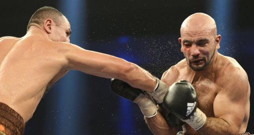 Armenian-German super middleweight boxer Arthur Abraham (L) punches French challenger Mehdi Bouadla on December 15, 2012