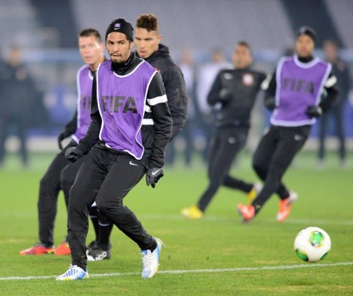 Corinthians defender Wallace (front) takes part in a team training session in Yokohama on December 15, 2012