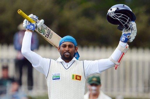 Sri Lanka's Tillakaratne Dilshan celebrates after scoring a century in the first Hobart Test on December 16, 2012