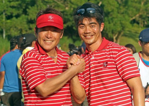Asia Team Captain Naomichi Joe Ozaki of Japan (left) and Vice Captain Lian Wen Chong celebrate