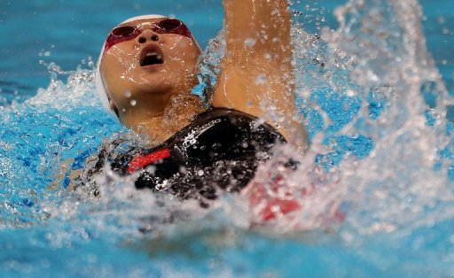 Zhao Jing competes in the women's 100m backstroke final during the Asian Swimming Championships on November 16, 2012
