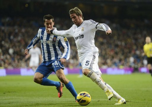 Real Madrid's Portuguese defender Fabio Coentrao (R) vies with Espanyol's midfielder Christian Alfonso